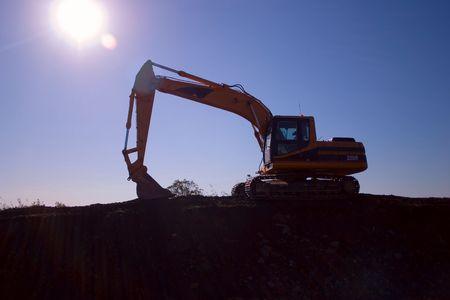 against the sun: Digger silouette against sun