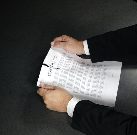 ripping up a contract photo
