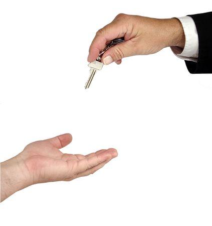 keys hand over against white background photo