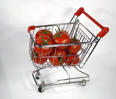 red tomatoes in shopping cart side view