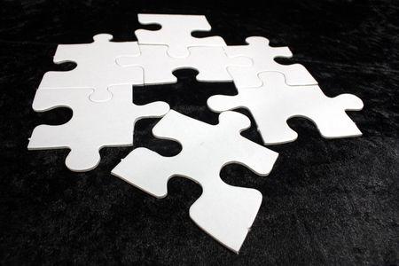 blank white jigsaw with black background