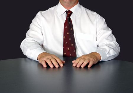 businessman waits at table Stock Photo