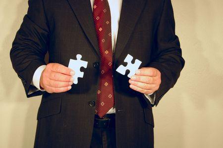 man with jigsaw Stock Photo