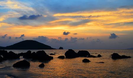 trad: Sunset at the beach - Trad Thailand Stock Photo