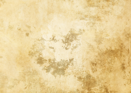 Old dirty and yellowed paper background for design.