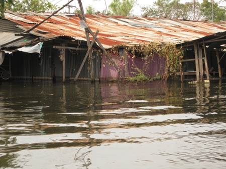 hovel: LAMLUKKA (PATHUMTHANI), THAILAND � CIRCA NOVEMBER 2011 � A hovel severely hit by the flood circa November 2011 in Lamlukka. The entire province has been flooded as a result of an exceptional and unprecedented rainy season.