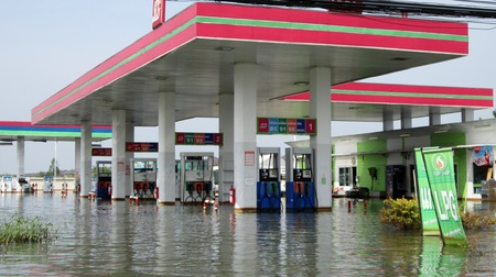 LAMLUKKA (PATHUMTHANI), THAILAND � CIRCA NOVEMBER 2011 � Flooded petrol station circa November 2011 in Lamlukka. The entire province has been flooded as a result of an exceptional and unprecedented rainy season.