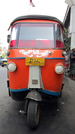 bajaj: A Bajaj (a typical Indonesian vehicle on three wheels). This one has been photographed in Jakarta.