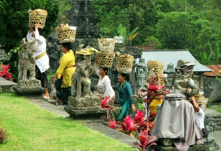 BALI � INDONESIA: A group of devotees brings offerings to the gods in the Hindu temple Pura Besakih (Mother Temple) circa October 2011 in Bali.                         Stock Photo - 11652218