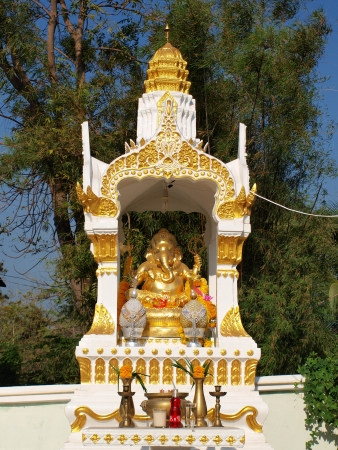 Ganesh is a Hindu deity and is the son of Paravati and Shiva photo