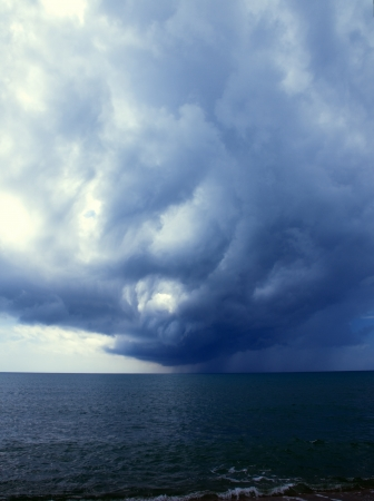 approaches: A storm from the ocean approaches the coast Stock Photo