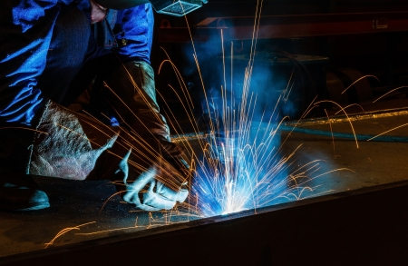 Welding and bright sparks. Hard job photo