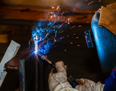 Welding with sparks by MIG method photo