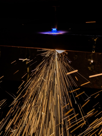 Gas cutting with sparks close up photo
