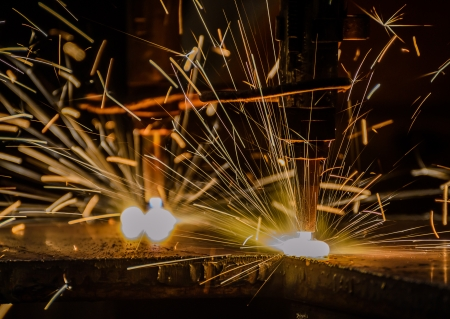 Gas cutting of the metal with sparks close up