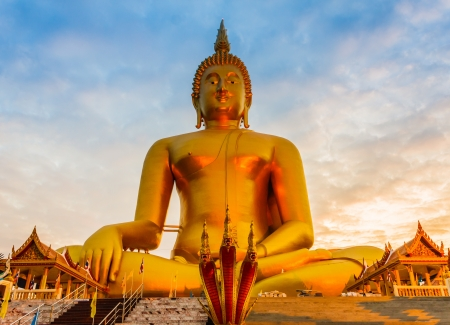 angthong: Largest Buddha statue on sunset sky background at Ang-Thong, Thailand