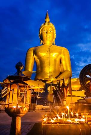 largest tree: Largest Buddha statue on twilight at Ang-Thong, Thailand Stock Photo