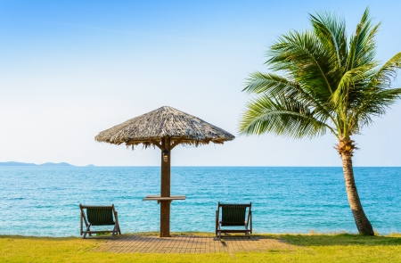Tropical beach landscape with deckchair and parasol at Rayong, Thailand