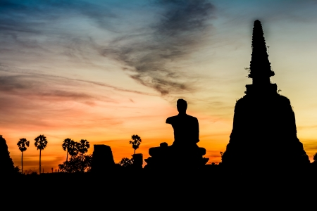 Silhouette of buddha after  sunset in Ayutthaya, Thailand photo