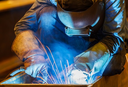 mig: MIG welder in a factory Stock Photo
