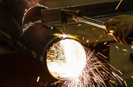 Metal cutting with acetylene torch photo
