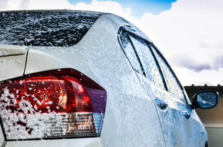 dirty car: car getting a wash with soap Stock Photo