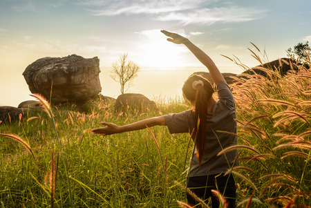 arms  outstretched: Teenage girl enjoy with sunshine in wheat field Stock Photo