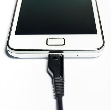 Charging mobile phone isolated on white background photo