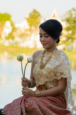 Thai women welcome with traditional Thai suit