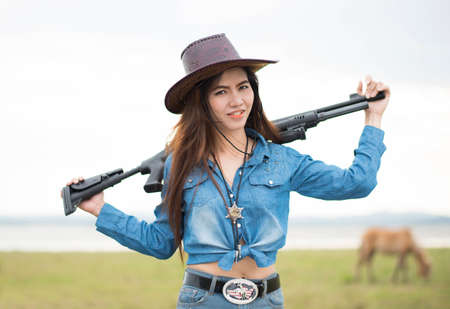 Beautiful cowgirl with her gun