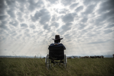 immobility: Lonely disabled man in wheelchair