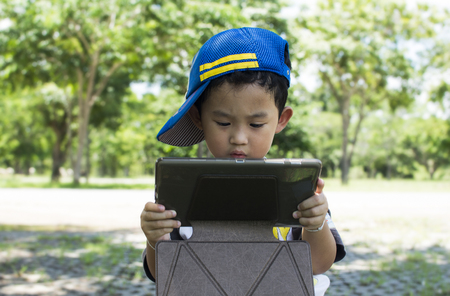 serious child playing game ontablet Stock Photo