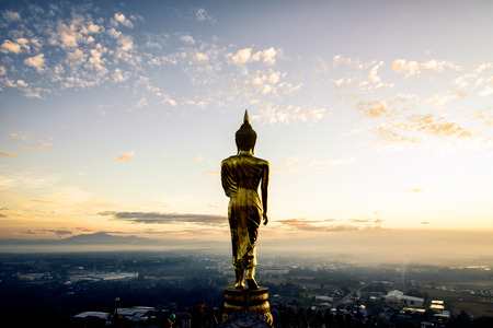Big Buddha statue on sunrise sky Stock Photo