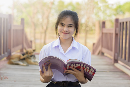 AYUTTHAYA THAILAND- JAN 30 : A student is reading a English book for test at garden on January 30, 2016 in Somdet garden in Ayutthaya, Thailand