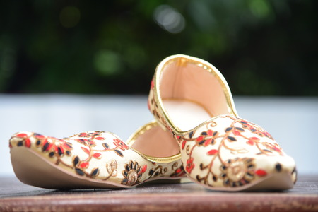 Designer embroidered Shoes of Indian Groom, golden red and black embroidery beautifully done on cream base colour shoes.