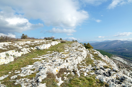 expanse: Rocks and remains of the buildings of the ancient city. Mountains on the horizon