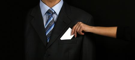 Businesswomen holding a card near man in suit photo