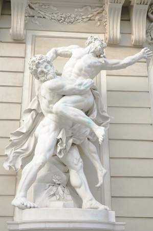 antique statue of two greek male gods wrestling each other Stock Photo