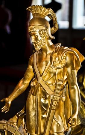 bronze statue of a male greek warrior photo
