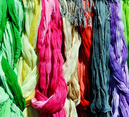 scarves: a set of colorful scarves on a rack on a local market in vienna