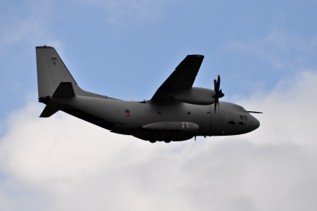 military tactical air-transport and cargo plane in flight Stock Photo