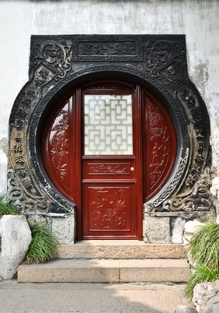 wood carving door: red wooden chinese gate, masterfully carved