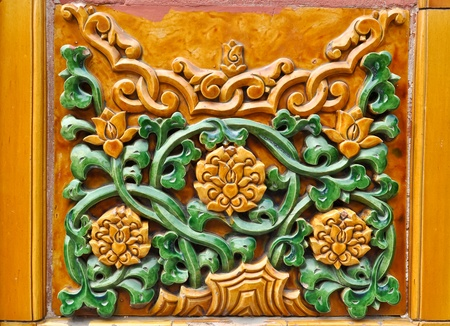 colorful chinese wall ornament in beijings forbidden city photo