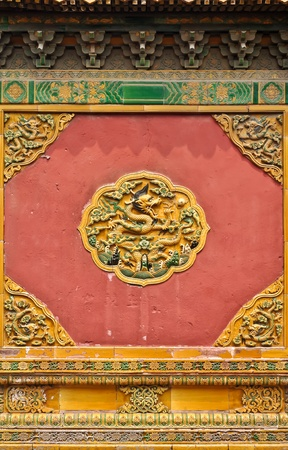 stone carving: colorful chinese wall ornament in beijings forbidden city