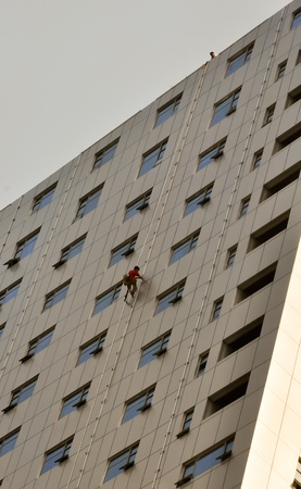 acrophobia: window cleaner rapelling from a skyscraper in china