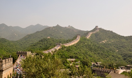 a segment of the great wall of china with tourists in badalin photo