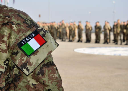 close up of an italian uniform with digital camouflage pattern and the national flag at a parade with KFOR troops in Kosovo