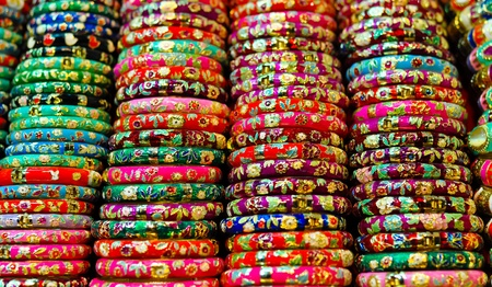 closeup on colorful bracelets for sale on a street market photo