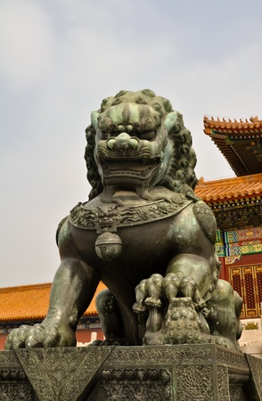 a bronze lion statue guarding the forbidden city in beijing Stock Photo