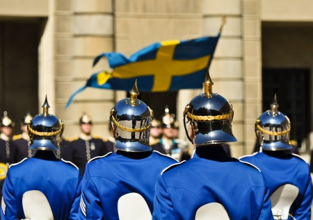 swedish soldiers with shiny helmets in front of the royal palace in stockholm photo